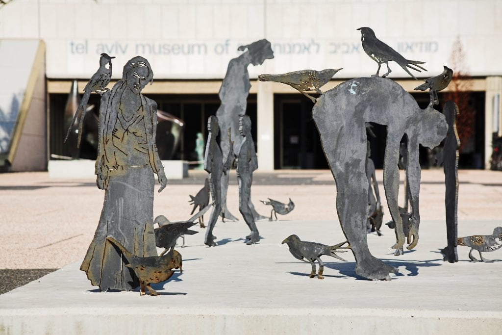 Sculptures of humans and birds
